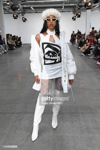 Guest attends the Fashion East show during London Fashion Week Men's June 2019 at the BFC Show Space on June 09 2019 in London England