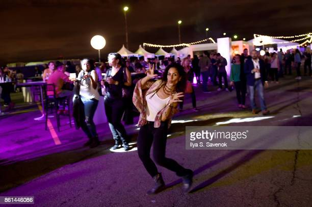 A guest attends the Food Network Cooking Channel New York City Wine Food Festival presented by CocaCola Rooftop Iron Chef Showdown Battle Autumn...