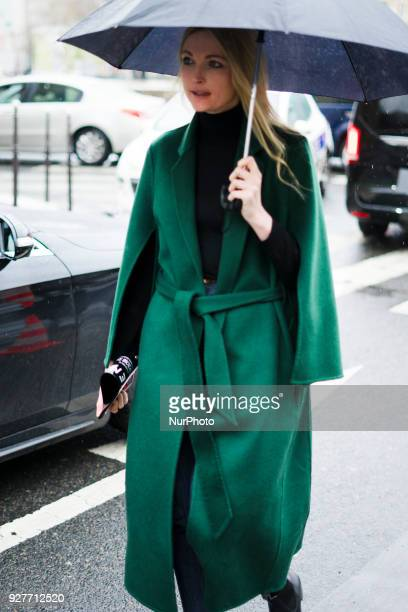 Guest attends The Givenchy Show During Paris Fashion Week on March 4 2018 in Paris France