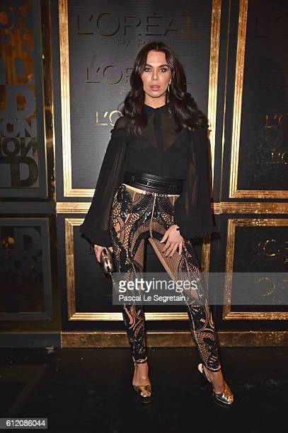 A guest attends the Gold Obsession Party L'Oreal Paris Photocall as part of the Paris Fashion Week Womenswear Spring/Summer 2017 on October 2 2016 in...