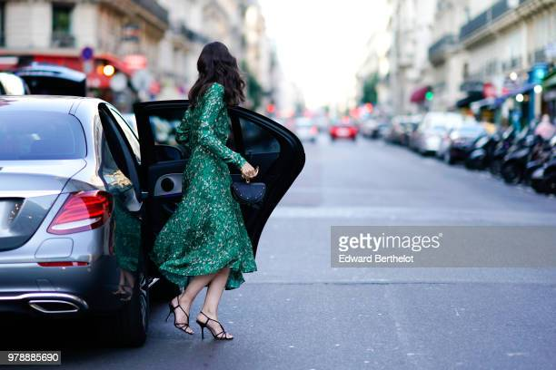A guest attends the HM Flaship Opening Party as part of Paris Fashion Week on June 19 2018 in Paris France