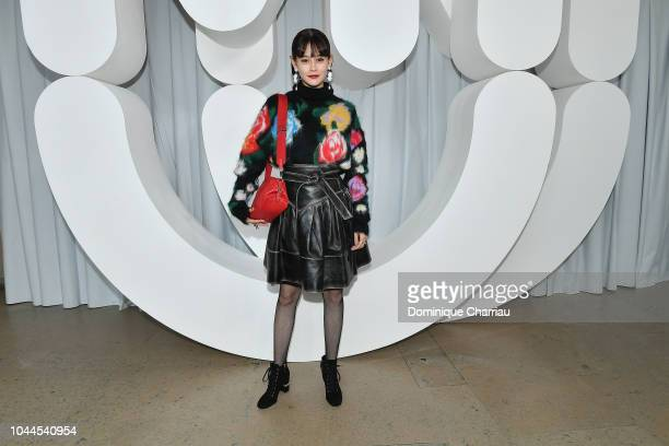 A guest attends the Miu Miu show as part of the Paris Fashion Week Womenswear Spring/Summer 2019 on October 2 2018 in Paris France