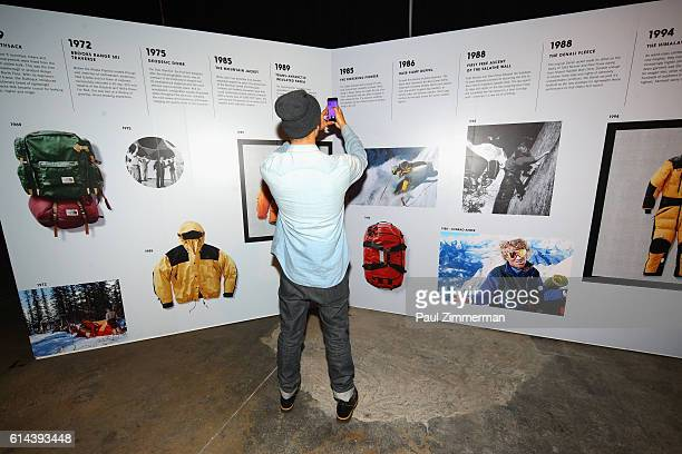 A guest attends The North Face event celebrating the company's 50th anniversary and debuting its global brand campaign at the Lowline Lab on October...