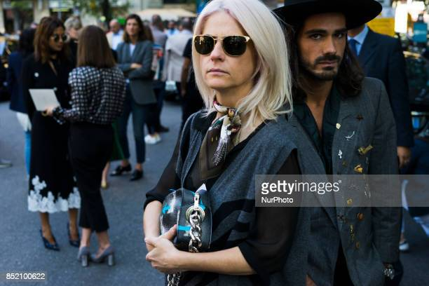 A guest attends the Sport Max show during Milan Fashion Week Spring/Summer 2018 on September 22 2017 in Milan Italy