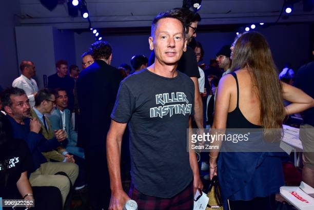 A guest attends the Todd Snyder S/S 2019 Collection during NYFW Men's July 2018 at Industria Studios on July 11 2018 in New York City