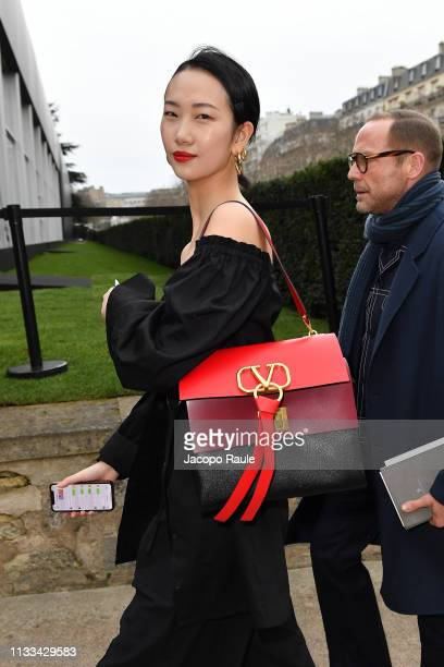 Guest attends the Valentino show as part of the Paris Fashion Week Womenswear Fall/Winter 2019/2020 on March 03 2019 in Paris France