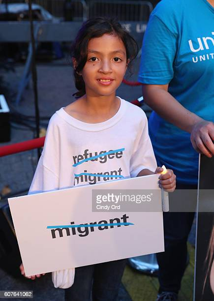 A guest attends US Fund for UNICEF as it calls on world leaders to put children first during a candlelight vigil at Dag Hammarskjold Plaza on...