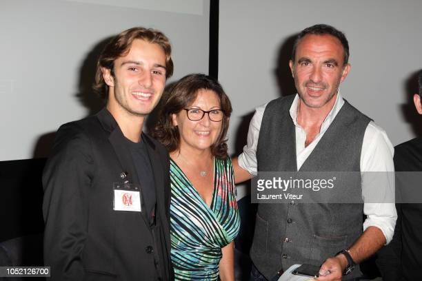 Guest Auctioner Lucie Donikian and Nikos Aliagas attend 'Les Amis de Yann ArthusBertrand se Vendent aux Encheres' Auction in Domaine de Longchamps on...