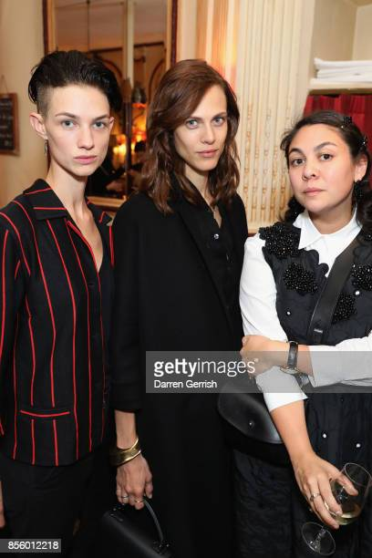 Guest, Aymeline Valade and Simone Rocha attend a dinner in Paris to celebrate Another Magazine A/W17 hosted by Vivienne Westwood, Andreas Kronthaler,...