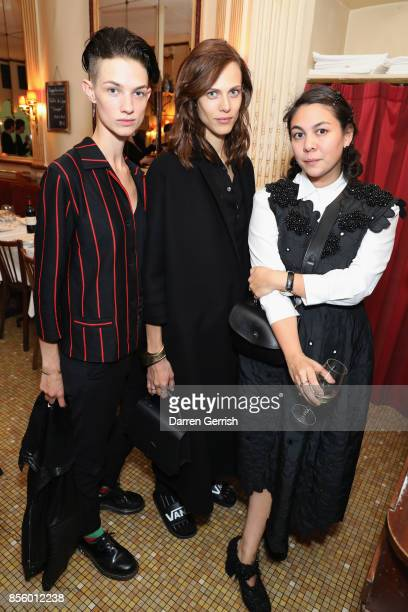 A guest Aymeline Valade and Simone Rocha attend a dinner in Paris to celebrate Another Magazine A/W17 hosted by Vivienne Westwood Andreas Kronthaler...