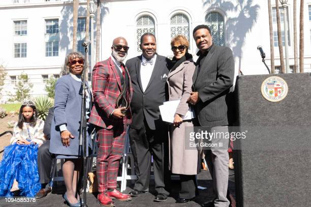 guest BeBe Winans Mike Davis Leslie Sykes and Dr Bishop Ulmer pose for a photo as BeBe Winans is honored with the Living Legend Award For...
