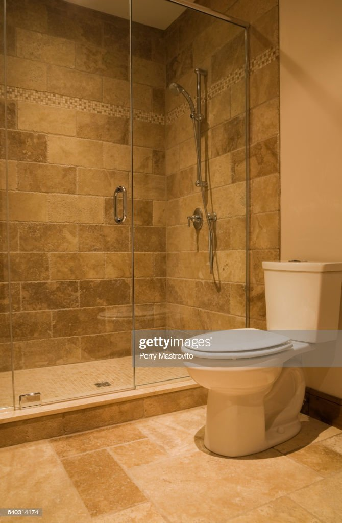 Guest Bedroom Ensuite With White Toilet And Glass Shower Stall Stock ...
