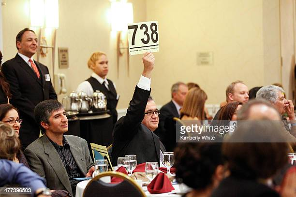 A guest bids on an item during an auction at the PARS Equality Center 4th Annual Nowruz Gala at Marriott Waterfront Burlingame Hotel on March 8 2014...