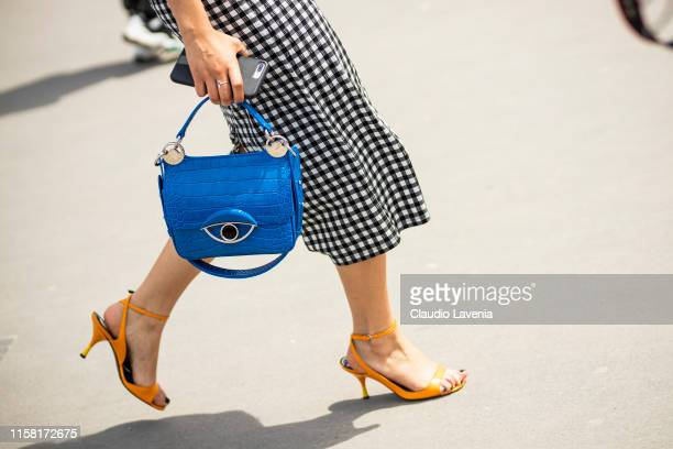 Guest, blue Kenzo bag details, is seen outside Kenzo fashion show on Day 6 during the Paris Fashion Week Spring/Summer 202> on June 23, 2019 in...