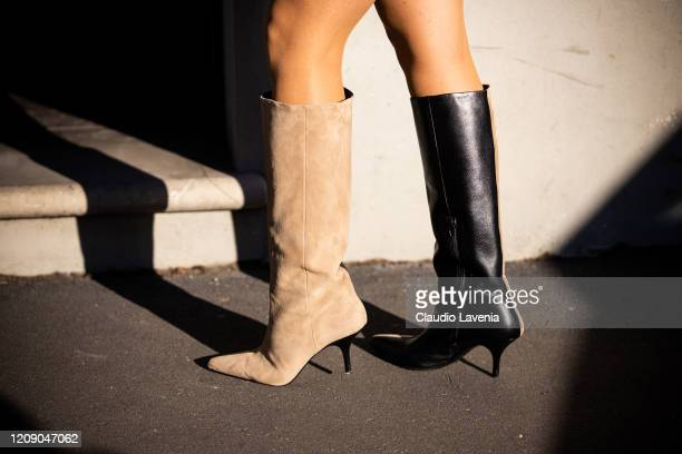 Guest, boots details, is seen outside Tod's show, during Milan Fashion Week Fall/Winter 2020-2021 on February 21, 2020 in Milan, Italy.
