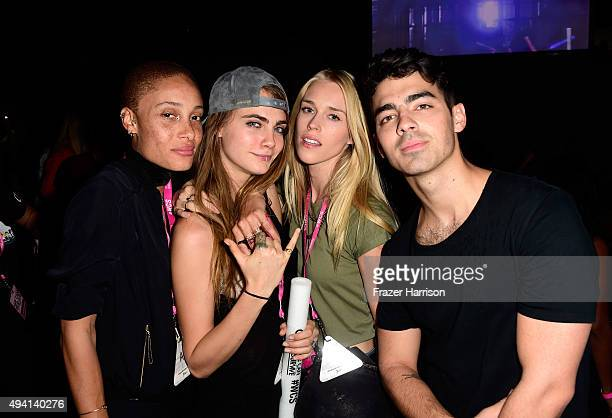 Guest Cara Delevingne Mary Charteris and Joe Jonas during CBS RADIOs third annual We Can Survive presented by Chrysler at the Hollywood Bowl on...