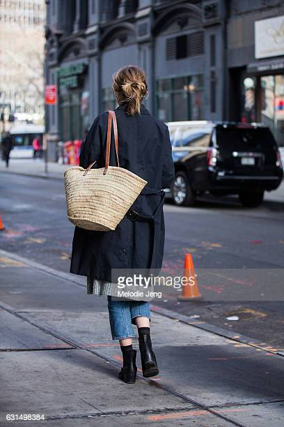 A guest carries a wicker bag outside the Valentino PreFall 2017 Fashion Show at Beekman Hotel on January 11 2017 in New York City