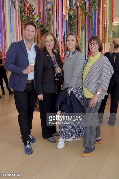Guest Cathy Wills Jo StellaSawicka and guest attend The Art of Wishes preview and opening reception ahead of the The Art of Wishes Gala and Auction...