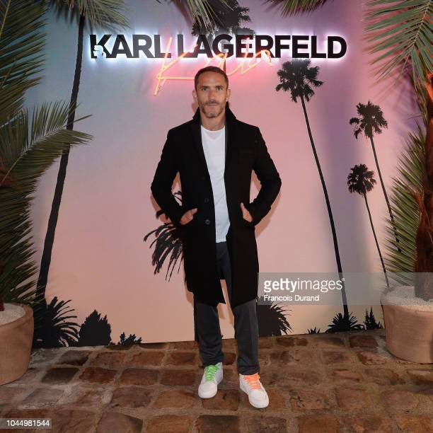 A guest celebrates the launch of the Karl x Kaia collaboration capsule collection on October 2 2018 in Paris France