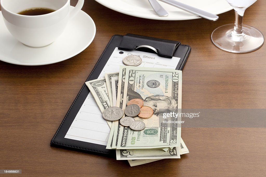 Guest check with Cash and Coin : Stock Photo