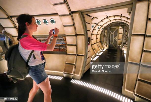 Guest checks out the inside of the Millennium Falcon: Smugglers Run attraction at Black Spire Outpost during a sneak peek for invited guests of the...