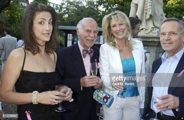 Guest, Chef Anton Mosimann, actress Fiona Macpherson and Lord Jeffrey Archer attend the Kit-Kat Club garden party, founded by Ghislaine Maxwell, to...