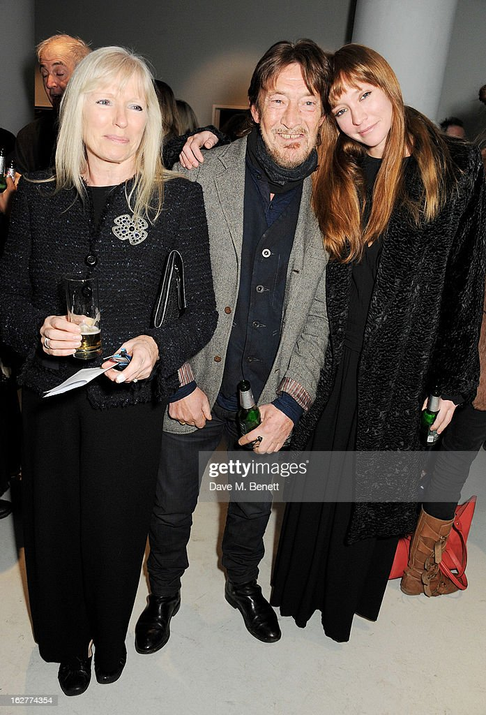Guest, Chris Rea and daughter Josephine attend a private view of Bill Wyman's new exhibit 'Reworked' at Rook & Raven Gallery on February 26, 2013 in London, England.