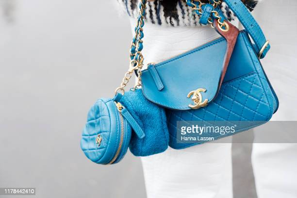 Guest, clutch detail, wearing Chanel jacket and bag outside the Chanel show during Paris Fashion Week Womenswear Spring Summer 2020 on October 01,...