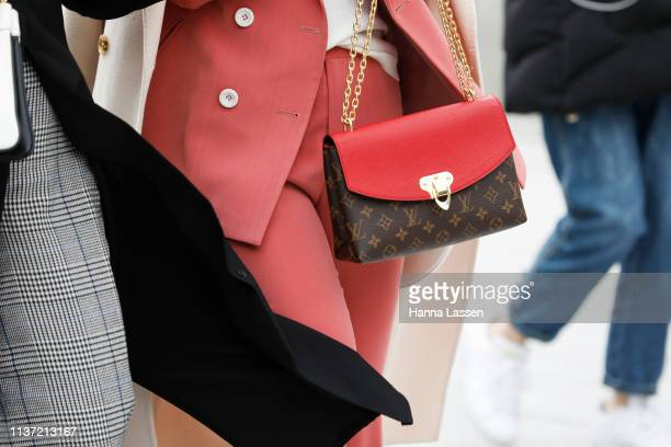 Guest clutch detail wearing Louis Vuitton bag is seen at the Hera Seoul Fashion Week 2019 F/W at Dongdaemun Design Plaza at Dongdaemun Design Plaza...