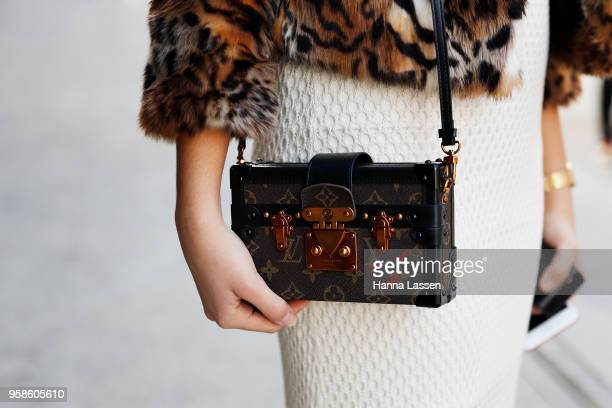 A guest clutch detail wearing Louis Vuitton clutch during MercedesBenz Fashion Week Resort 19 Collections at Carriageworks on May 15 2018 in Sydney...