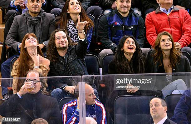 Guest Constantine Maroulis guest and Vika Levina attend the Detroit Red Wings vs New York Rangers game at Madison Square Garden on January 16 2014 in...