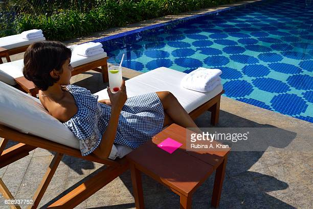 A guest cools off by the pool with an iced lemonade at the newlyopened W Goa the first W hotel in India on December 10 2016 in Goa India