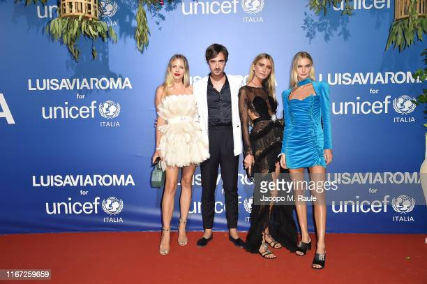 Guest Daniele Cavalli Lisa Kistermann and Jessica Kistermann attend the photocall at the Unicef Summer Gala Presented by Luisaviaroma at on August 09...