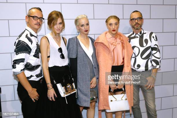 Guest DJ Caitlin Moe and DJ Mia Morretti between Fashion Designers Viktor Rolf after their show as part of the Paris Fashion Week Womenswear...