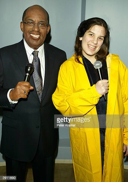 A guest dressed as a weather forecaster poses with the Do The Weather With Al experience wax figure at Madame Tussauds New York January 29 2004 in...