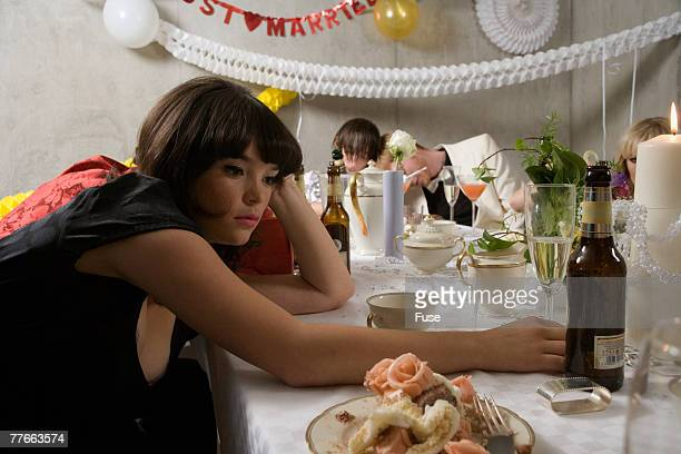 Guest Drinking Champagne at Wedding Reception