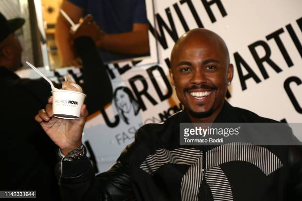 A guest eats ice cream as Fashion Nova Presents Party With Cardi at Hollywood Palladium on May 9 2019 in Los Angeles California