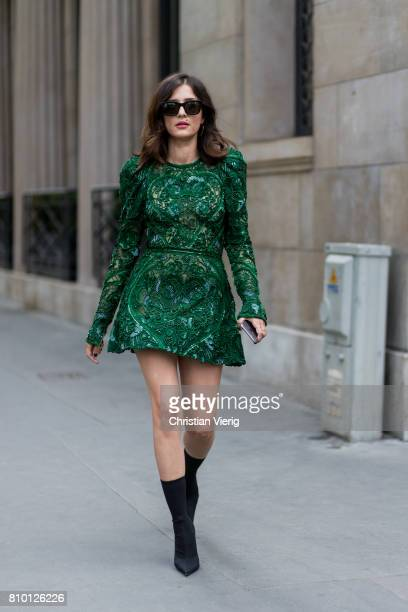A guest Eleonora Carisi wearing a green dress ankle boots outside Elie Saab during Paris Fashion Week Haute Couture Fall/Winter 20172018 Day Four on...
