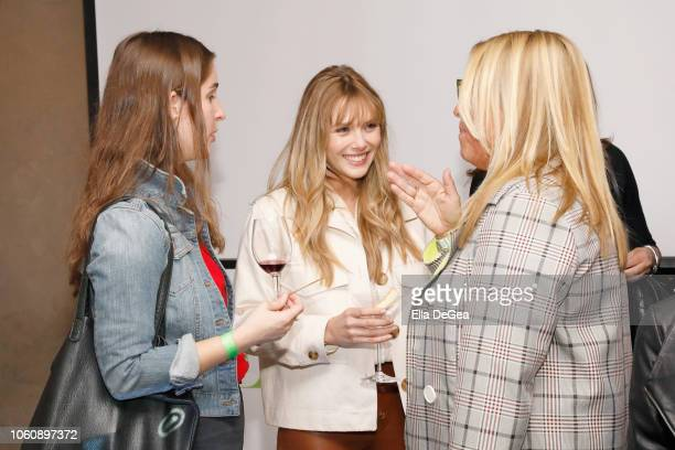 Guest Elizabeth Olsen and Cynthia Pett Dante attend the EBMRF hosts Sip Savor Support at Wally's Beverly Hills on November 12 2018 in Beverly Hills...