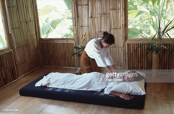 A guest enjoys a relaxing Thai massage at the Phu Chai Sai resort in the highland's of northern Thailand's Chiang Rai province The resort set on a...