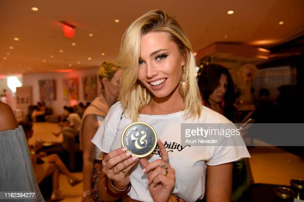 A guest enjoys Black River Caviar at Miami Swim Week Powered By Art Hearts Fashion Swim/Resort 2019/20 at Faena Forum on July 15 2019 in Miami Beach...