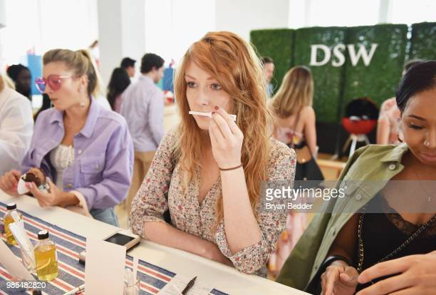 A guest enjoys the Create Your Own Scent station during the DSW Block Party hosted by Olympians Adam Rippon and Mirai Nagasu on June 27 2018 at...