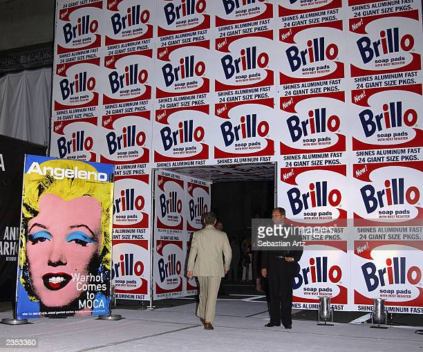 A guest enters the Andy Warhol Retrospective at the Museum of Contemporary Art on its opening night May 22 2002 in Los Angeles CA The show is the...