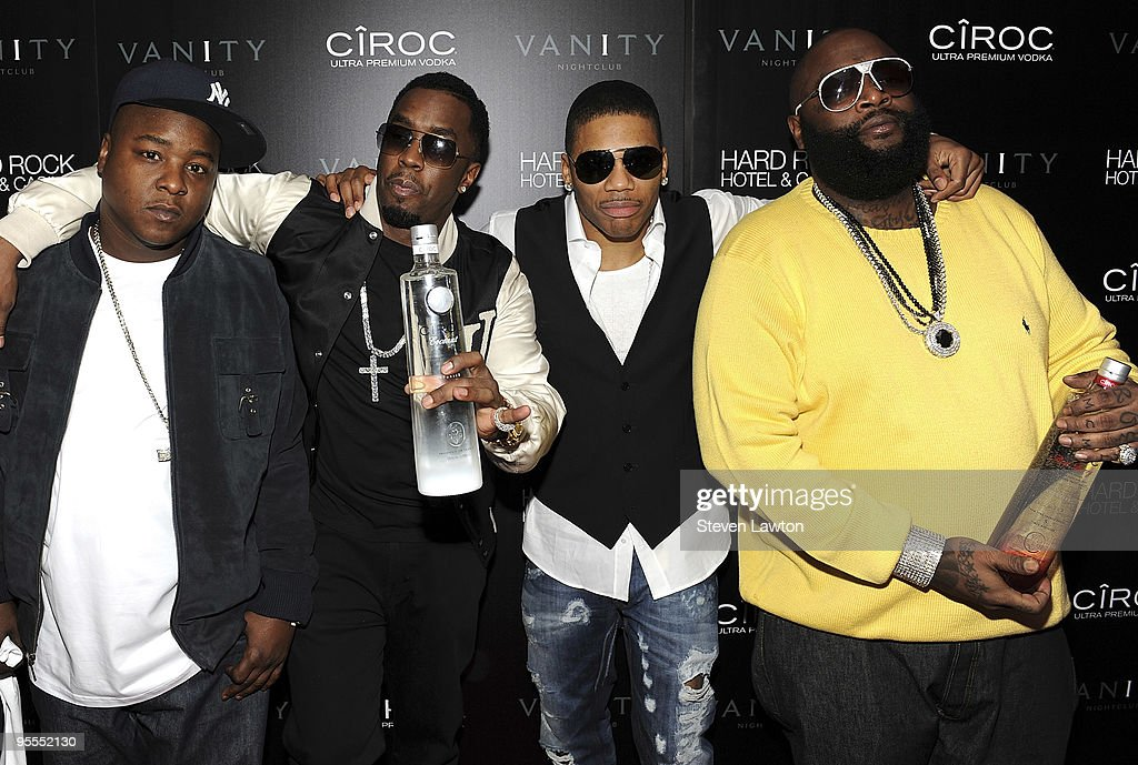 Guest, Fashion designer/recording artist Sean 'Diddy' Combs, recording artist Nelly and recording artist Rick Ross attend the grand opening of the Vanity nightclub hosted by Sean Diddy Combs at the Hard Rock Hotel and Casino on January 2, 2010 in Las Vegas, Nevada.