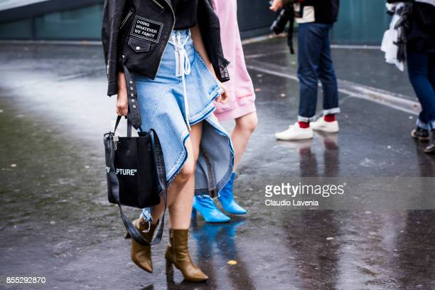 A guest fashion detail is seen before the Ann Demeulemeester fashion show during Paris Fashion week Womenswear SS18 on September 28 2017 in Paris...