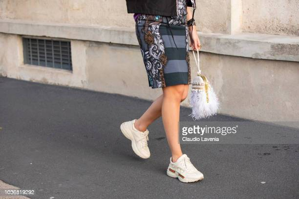 Guest, fashion detail, is seen in the streets of Milano before the Prada show during Milan Fashion Week Spring/Summer 2019 on September 20, 2018 in...