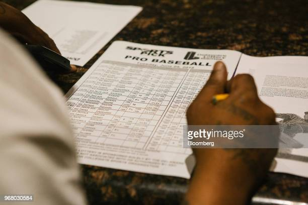A guest fills out a pick sheet during the launch of fullscale sports betting in Dover Delaware US on Tuesday June 5 2018 Delaware became the first US...