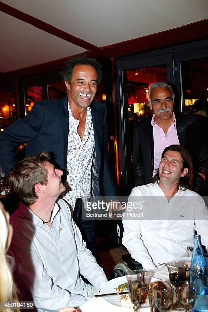 Guest Former tennis players Yannick Noah Mansour Bahrami and Jerome Golmard attend the Legends of Tennis Dinner Held at Restaurant Fouquet's whyle...