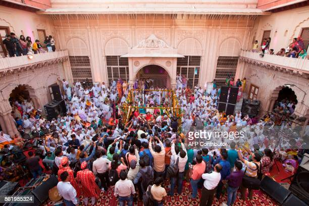 Guest gather around Vinita Devi a former widow and Rakesh Kumar during their wedding ceremony at Gopinath temple in the Vrindavan on October 16 2017...