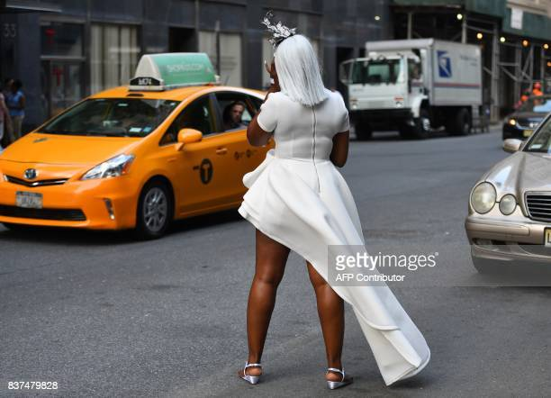 Guest gather in the street as the wait to attend the annual New York City Diner en Blanc August 22 2017 held this year at the plaza at Lincoln Center...